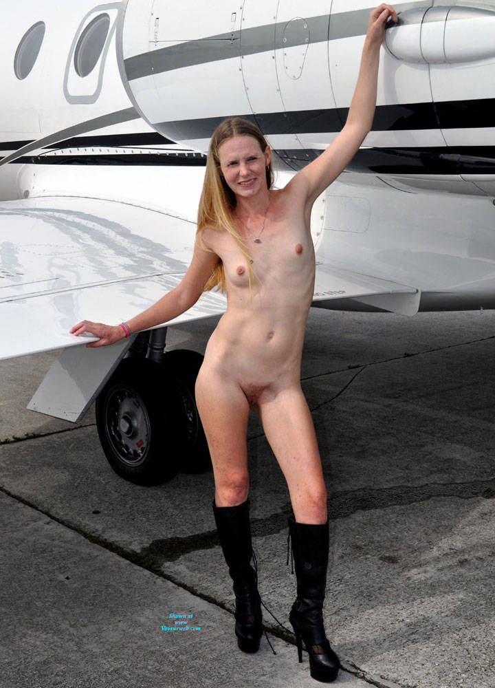 naked milf in airoplane